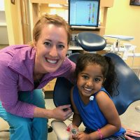 A photo of Dr. Kristin Lawson with a patient smiling after her appointment at Just for Kids Pediatric Dentistry